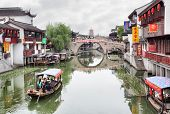 SHANGHAI, CHINA - APRIL 11, 2014: Boats in the main cana in Qibao water village