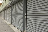 stock photo of roller door  - View of corrugated metal doors of garages