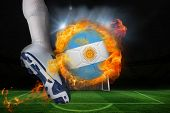 picture of football pitch  - Football player kicking flaming argentina flag ball against football pitch and goal under spotlights - JPG