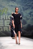 ZAGREB, CROATIA - MAY 09: Fashion model wearing clothes designed by Iva Karacic on the Zagreb Fashion Week on May 09, 2014 in Zagreb, Croatia.