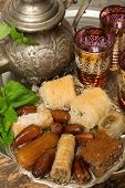 Traditional dates and cookies on a Moroccan tea tray