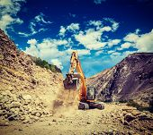 pic of jammu kashmir  - Vintage retro effect filtered hipster style travel image of Excavator doing road construction in Himalayas - JPG