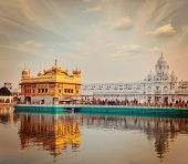 Vintage retro effect filtered hipster style travel image of Sikh gurdwara Golden Temple (Harmandir S