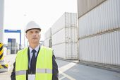 Middle-aged male worker looking away in shipping yard