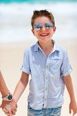 Summer portrait of cute happy little boy on vacation