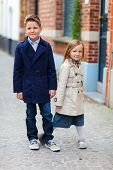 Kids outdoors in city on beautiful spring or autumn day