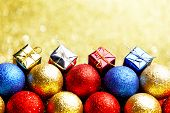 Pile of colorful Christmas balls with blurred background
