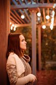 Woman portrait in evening lantern lights outdoor.