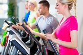 picture of treadmill  - Group of fitness people in sport gym on treadmill - JPG