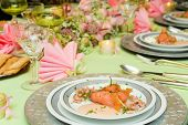 Smoked salmon appetizer served on a festive christmas dinner table