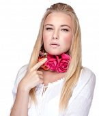 Portrait of attractive female with stylish floral accessories on the neck, isolated on white background, beauty and fashion concept