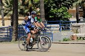Cyclists on promenade, Malaga.