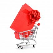 a red gift box with a red ribbon in a shopping cart on a white background