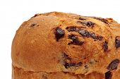 closeup of a panettone, a typical Italian sweet for Christmas time, on a white background
