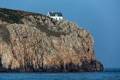 Home sitting on a high cliff in the Ushant island (aka Ouessant), Brittany, France