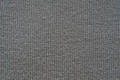 Texture From A Soft Knitted Fabric Of Gray Color