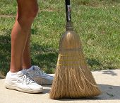 Woman's feet and broom