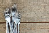 Retro Forks On Wooden Table