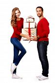 Two happy young people in love give each other gifts. Isolated over white.