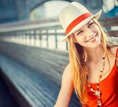 Young attractive girl in a hat