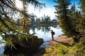 The hiker man at the beautiful Lago Di Federa See early morning