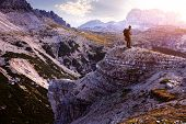 Italy Dolomites - Male hiker standing on the barren rocks