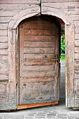 image of front-entry  - Architecture detail with a very old wooden house front door - JPG