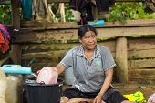 BAAN LOOK KAO LAM, THAILAND, NOVEMBER 19, 2012 : Unidentified woman is washing her laundry in the village of Ban look Kao Lam, north Thailand, on November 20, 2012
