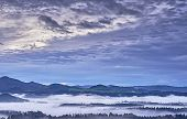 Hilly Landscape With Fog