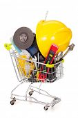 Shopping cart full of construction tools, isolated on white background