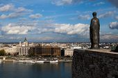 BUDAPEST, HUNGARY - OCT 21 2014 : A statue gazes across the Danube at the St Stephen's Basilica.