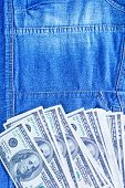 dollar bill on denim