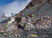 Colorful Thorung-la Pass (5400M) Marker In Nepali Himalayas