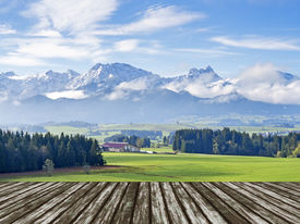 stock photo of bavaria  - Landscape in Allgau Bavaria with mountains and meadows and wooden floor - JPG