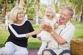 image of granddaughter  - Affectionate Granddaughter and Grandparents Playing Outside At The Park - JPG