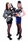 stock photo of assault-rifle  - Two women in the marine and the military uniforms with the assault rifles isolated over white background - JPG