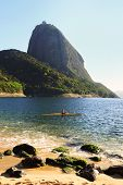stock photo of canoe boat man  - Mountain Sugarloaf Red beach  - JPG