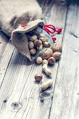 picture of ground nut  - Biological nuts and almonds isolated on wood background - JPG