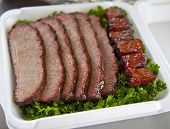 picture of brisket  - BBQ beef brisket on a bed of parsley - JPG