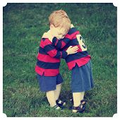 pic of baby twins  - Twin baby boys hugging in rugby clothing with Instagram effect filter - JPG