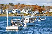 stock photo of lobster boat  - Lobster fishing vessels at sunset in Maine - JPG