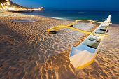 pic of waikiki  - Waikiki beach at night with a yellow outrigger canoe - JPG