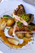 stock photo of veal  - Veal potatoes shallots and sauce on a plate - JPG