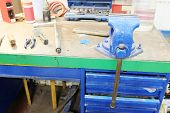foto of workbench  - The image of a old vice on a metal workbench - JPG