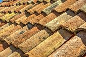 stock photo of red roof tile  - Old authentic roof red ceramic tiles background - JPG
