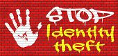 stock photo of theft  - identity theft stop warning sign stealing ID online is an internet or cyber crime graffiti on red brick wall - JPG
