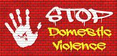 picture of child abuse  - domestic violence abuse or aggression within marriage against partner wife or children graffiti on red brick wall - JPG
