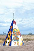 foto of tipi  - Colored tipi or teepee with designs in the fields of Arizona - JPG