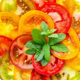 pic of mint-green  - Healthy natural food colorful Tomato Slices and green mint Fresh Organic Food isolated on white background closeup - JPG