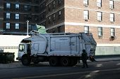 Garbage Truck Emptying Dumpsters